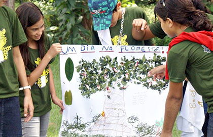 Children show a project about the forest and the environment